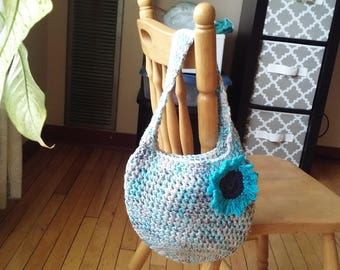 Crochet purse: blues, grays, and whites w/turquoise and dark gray flower