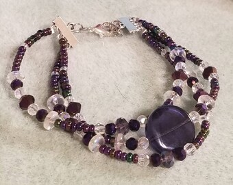 Purple and Iridescent Toned Glass Bead Three Strand Bracelet