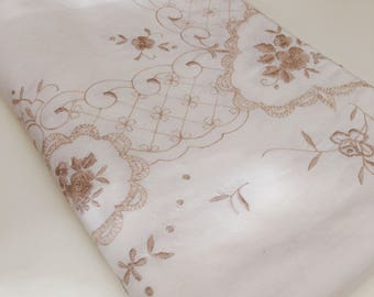 A gorgeous, large, vintage, cotton tablecloth decorated with beautiful, beige floral embroidery