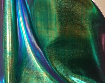 "New Iridescent all over foil blue/green nylon spandex 4way Stretch 58/60"" Sold by the YD. Ships worldwide from Los Angeles California USA"