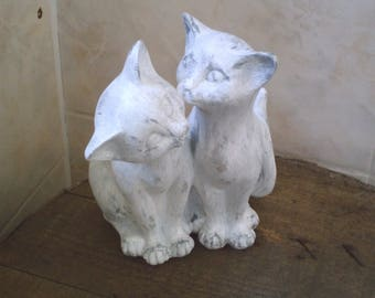 two cats embraced white patina
