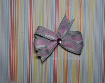 Gray with pink whales bow