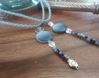 This cord necklace choker style necklace, dyed in shades of blue sky blue, stone and glass bead