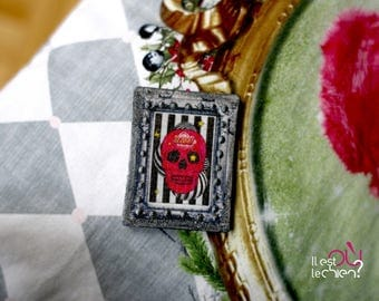 Silver brooch, pop pink skull on stripe background