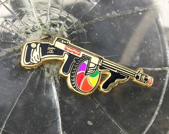 Gold hard enamel pin, Tommy gun machine gun enamel pin, fisher price lapel pin