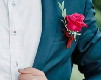 Red rose boutonnier for groom or groomsmen