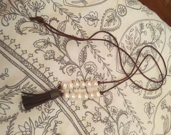 12 pearl, brown tassel necklace