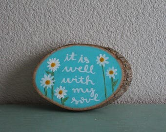 it is well hand painted wood slice