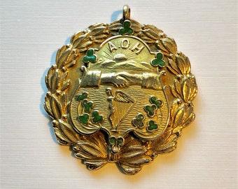 Vintage A.O.H. 1906 gold medal/pendant