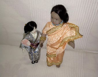 2 small porcelain dolls