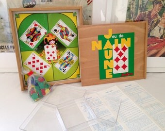 Old yellow dwarf with brand JEUJURA Checkers game. Vintage