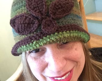 Gorgeous 1920's inspired handmade crochet cloche in Greens, blues with brown trimming