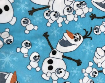 """Frozen Olaf Fleece Fabric is 58"""" - 60"""" wide and 100% Dr polyester. Disney"""