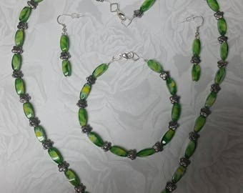 Peridot swirl and flower Necklace.  Bracelet and earrings.