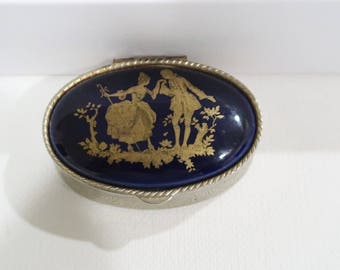 Small blue pillbox with romantic english countryside setting and etching