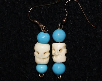 Handmade Earrings~Blue glass beads and Hand Carved Skull Beads by Tibetan Monks