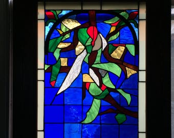 Handmade stained glass window in pine frame. Original design by artist. One of a kind .