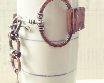 Asymmetrical chain link bangle