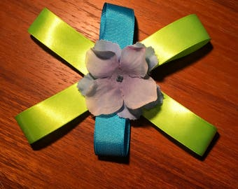 Blue and green flowed hand crafted hair bow