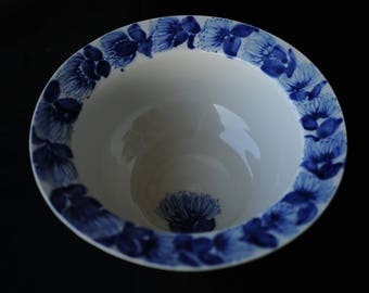 Hand thrown Porcelain bowl with hand painted lehua blossom lei on rim.