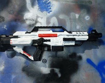 White and black nerf gun with distressed weathering