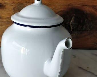 enamelled white teapot