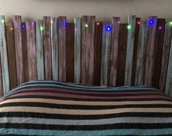 "Wooden headboard made with slats in gradient colors ""pastel"" LED inlaid"