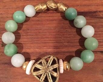 A gold triangle bracelet