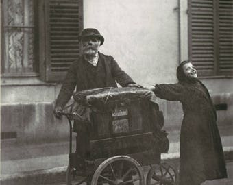 By Eugène Atget Street musician.