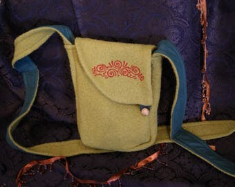Embroidered shoulder bag with red wool ornament