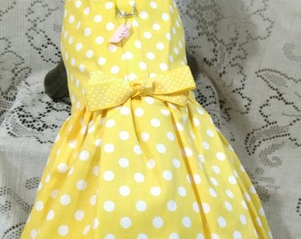 Yellow polka dotted harness dress