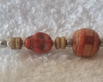 Roach Clip with Red Skulls