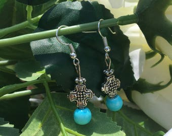 Silver cross earrings with turquoise at the bottom