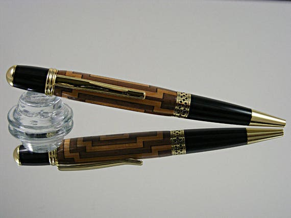 Handcrafted Inlayed Pen in Gold and a Segmented Cross Inlay