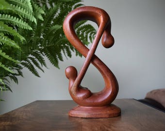 Infinity people carving