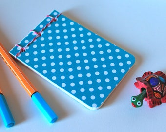 Little blue book with white polka dots
