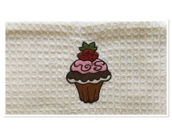 TOWEL EMBROIDERED WITH A CUPCAKE HONEYCOMB