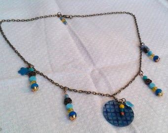 Blue flowers and bronze necklace