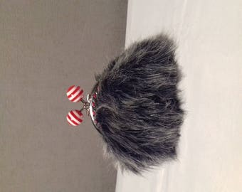 Faux fur coin purse with clasp decorated with striped balls