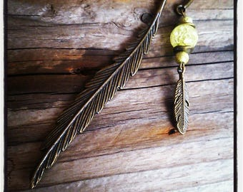 Yellow bead and charm bronze feather bookmark feather