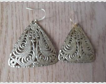 Gold metal filigree diamond earrings half