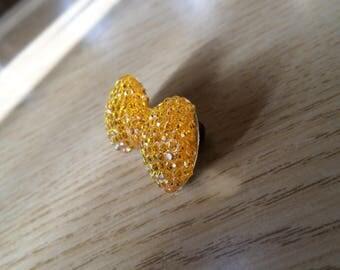 Girl's bright orange brooch