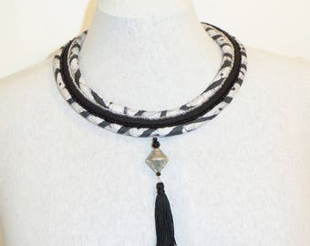 Bib necklace ethnic chic African fabric, beads and tassel, black and white tones