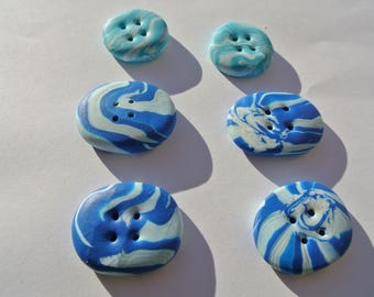 lot consists of six buttons blue and white