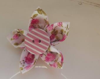 Pink fabric flower brooch.
