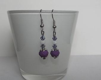 Purple swarovski stud earrings.