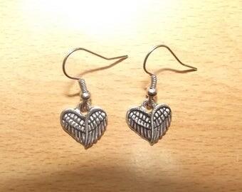 Earrings hand made heart charm.
