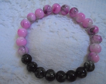 10% off Pink and black glass beaded stretch bracelet
