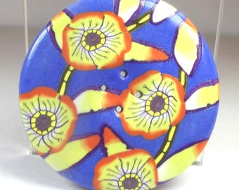 5 cm round sewing button: bamboo, and yellow flowers on blue background