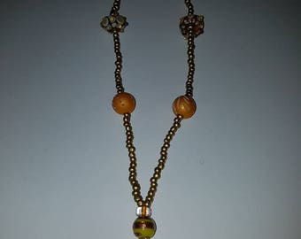 Handmade beaded necklace gold and yellow.